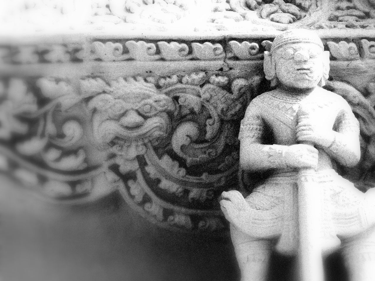 representation, art and craft, sculpture, creativity, statue, human representation, no people, male likeness, craft, architecture, religion, spirituality, carving - craft product, belief, close-up, place of worship, day, selective focus, pattern, building, ornate, carving, floral pattern