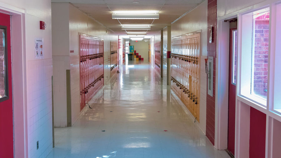School halway Arcade Architecture Building Built Structure Care Ceiling Corridor Diminishing Perspective Direction Empty Flooring Healthcare And Medicine Illuminated Indoors  Lighting Equipment No People Red Reflection The Way Forward Wall - Building Feature