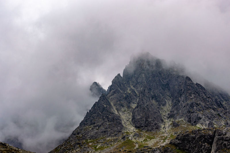 Hiking in High Tatras Beauty In Nature Cloud - Sky Day Environment Fog Geology Land Landscape Mountain Mountain Peak Mountain Range Nature No People Non-urban Scene Outdoors Power In Nature Rock Rock - Object Scenics - Nature Sky Solid Volcanic Crater