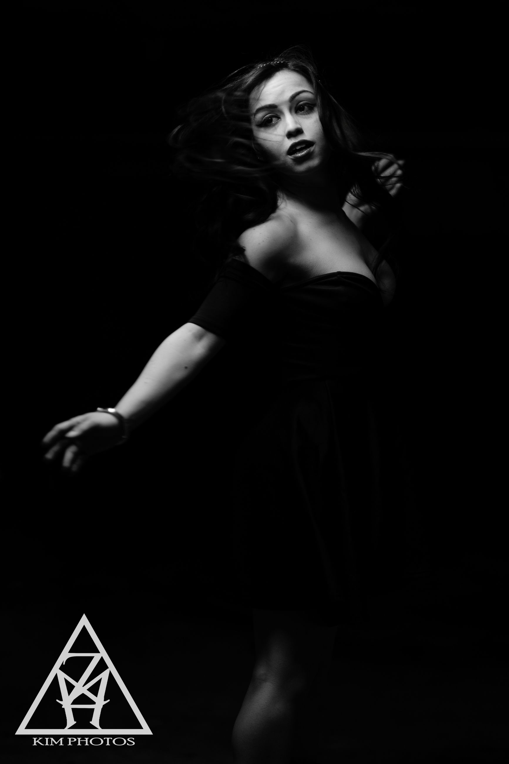 human representation, indoors, statue, art, young adult, sculpture, creativity, art and craft, front view, religion, night, spirituality, studio shot, low angle view, wall - building feature, black background