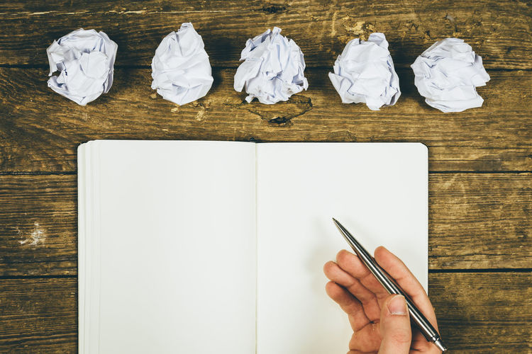 Paper Indoors  Wood - Material Table Pen Creativity Directly Above One Person Crumpled White Color High Angle View Crumpled Paper Group Of Objects Human Hand Hand Still Life Publication Book Planning Blank Note Pad Crumpled Paper Ball Finger