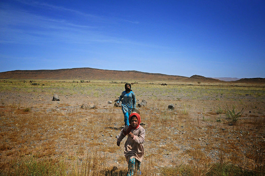 We met those Girls On Our Way to Ouarzazate. They were Running Asking For Help. Thirsty  Hungry and Injured. Exhausted by the Heat In The Middle Of Nowhere. Desert Landscape Sisters Women Of EyeEm Capturing Movement Capture The Moment Sunny Day Dry Season Deserts Around The World Roadtrip - Morocco Africa