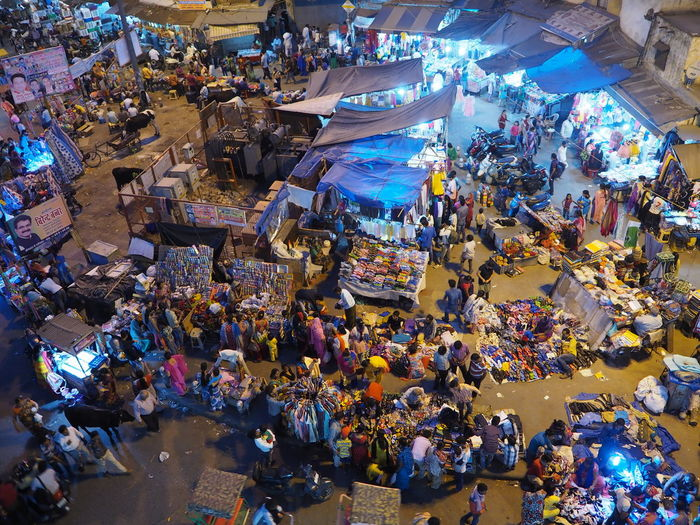 High angle view of people at illuminated bazaar during night