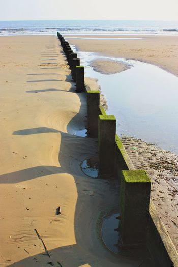 Sand shadows #3 EyeEm Nature Lover Beach Life Dymchurch Beach EyeEm Gallery EyeEm Selects EyeEm Best Shots Breakwater Shadow Sea Defences Beach Sea Sand Water Nature Shore Day Horizon Over Water Outdoors Beauty In Nature Tranquil Scene Tranquility Scenics No People Sky