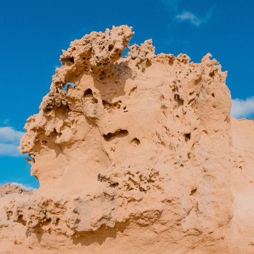 EyeEm Selects Rock Formation Geology Rock - Object Sky Nature Blue Physical Geography Low Angle View Beauty In Nature Day No People Outdoors Sunlight Scenics Rock Hoodoo Desert Arid Climate Ibiza Cala Conta