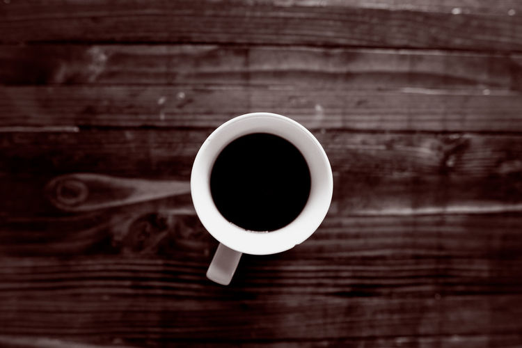 Black and white coffee cup on wood table Beverage Black And White Brown Close-up Coffee - Drink Coffee Cup Cup Day Directly Above Drink Duotone Food And Drink Freshness High Angle View High Contrast Indoors  Looking Down Moody No People Refreshment Saucer Table Wood - Material