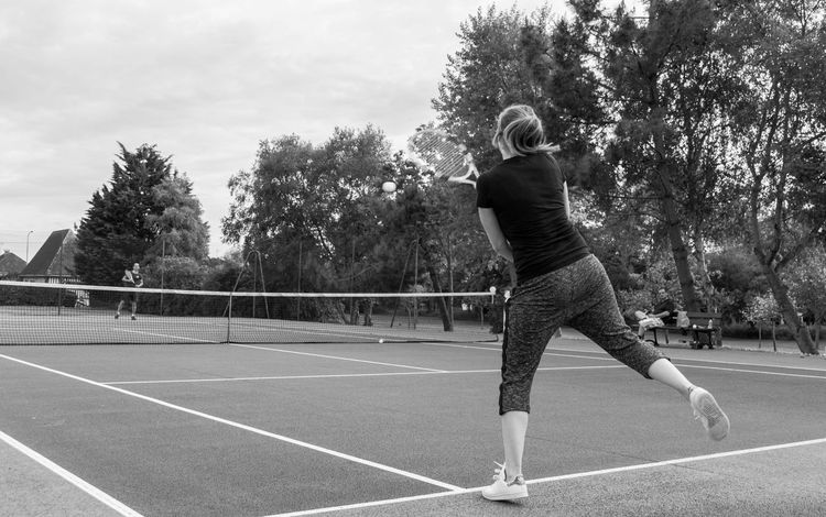 Adult Blackandwhite Competitive Sport Court Day Exercising Leisure Activity Lifestyles Outdoors Playing Racket Sport Real People Sport Tennis Tennis Ball Tennis Racket Women