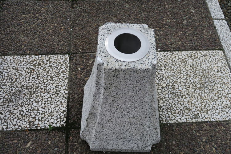 High angle view of bollard on cobblestone street