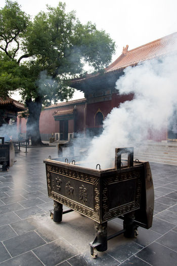 "Inside ""Lama temple"", Yonghegong, Beijing, China ASIA Beijing Lama Temple Sacred Places Smoke Travel Worship Architecture Buddhism Building Exterior Built Structure China Day Landmark Lifestyles Nature No People Outdoors Prayer Sky Smoke - Physical Structure Temple Temple - Building Travel Destinations Tree"