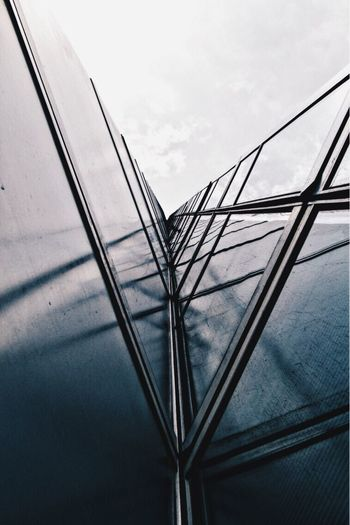 Sky No People Low Angle View Cloud - Sky Day Cable Built Structure Outdoors Architecture Nature Close-up Tall - High Modern Low Angle View Urban Skyline Building Exterior Architecture Tower Symmetrical