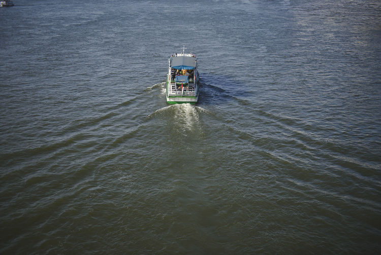 Boat moving away in the river Day Direction Floating On Water Guidance Mode Of Transportation Motion Nature Nautical Vessel No People Outdoors Protection Rippled Safety Sea Security Tower Transportation Travel Water Waterfront