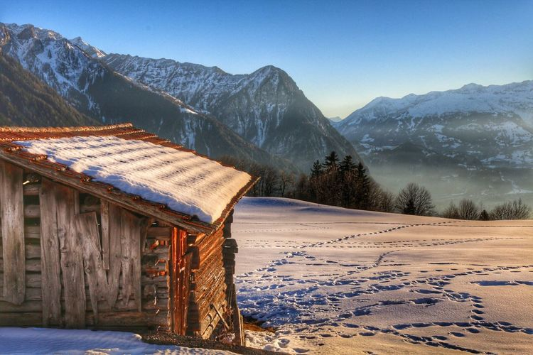 Snow Winter Cold Temperature Mountain Nature No People Clear Sky Scenics Beauty In Nature Built Structure Mountain Range Outdoors Day Sky Landscape Architecture