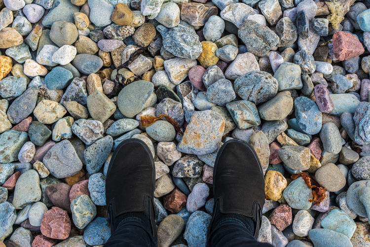 Exploring Style Beach Boot Change Colors and patterns Day EyeEm Best Shots EyeEm Nature Lover Footpath Footwear High Angle View Human Foot In Front Of Leisure Activity Lifestyles Limb Low Section Men Outdoors Pebble Person Personal Perspective Shoe Standing Surrounding