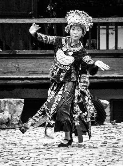 Miao Woman Performing Traditional Dance Dancing Miao Minority Adult Clothing Costume Dancer Day Front View Full Length Lifestyles One Person Real People Traditional Clothing Women