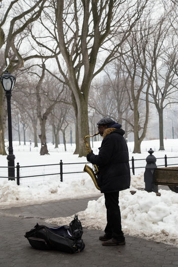 Central Park Man Street Artist Heat In The Snow Music Under The Snow One Person Real People Trumpet