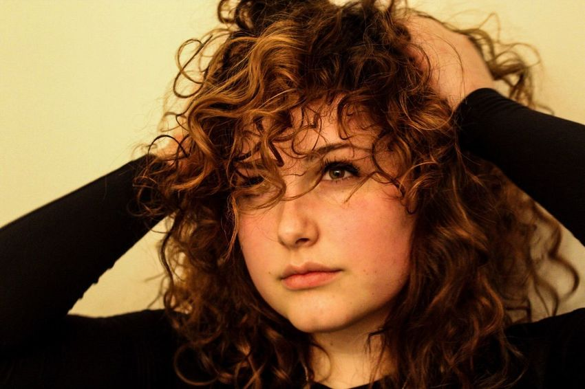 Straightface DifferentColors Photographer Photography Enjoying Life Beautiful Modeling Straightface Hands Fun Canada Warmth Curls Curly Hair Front View Young Adult One Person Real People Young Women Indoors  Portrait Day Lifestyles Close-up Looking At Camera