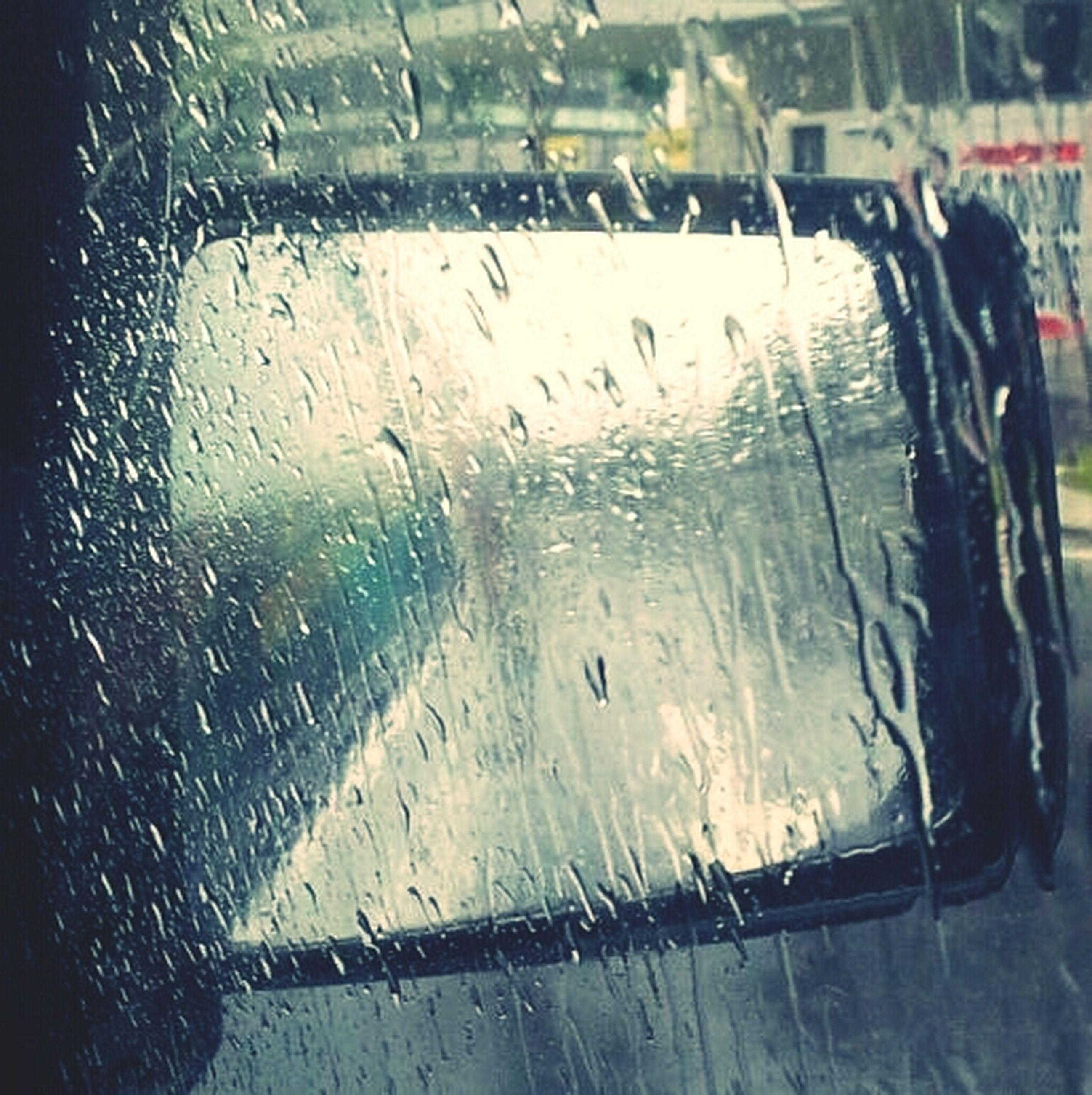 drop, wet, rain, window, glass - material, water, transportation, transparent, car, mode of transport, season, land vehicle, indoors, weather, vehicle interior, raindrop, close-up, windshield, monsoon, street