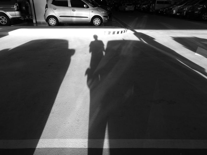 Shadow of cars on road in city