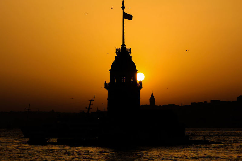 Architecture Beauty In Nature Built Structure Idyllic Istanbul Maidenstower Nature Orange Color Outdoors Rippled Scenics Silhouette Sky Sun Sunset Tranquil Scene Tranquility Travel Destinations Water