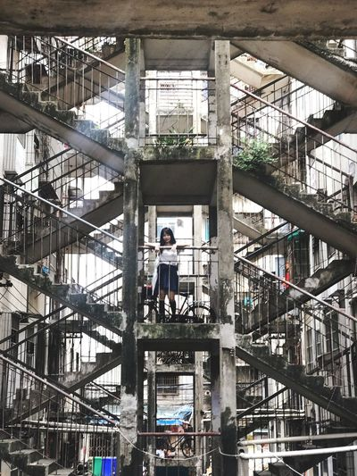 Woman Standing On Staircase Of Building