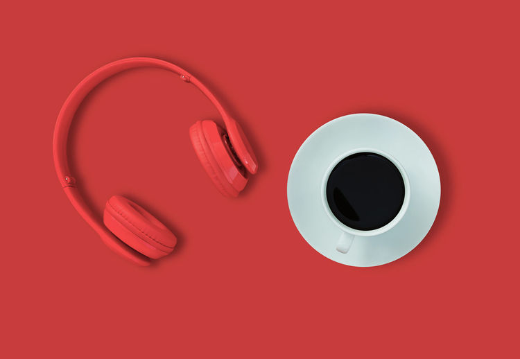 High angle view of coffee cup on red table