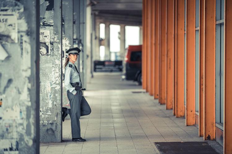 Side view of man in corridor of building
