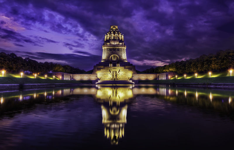 Battle of Nations Monument at night, Leipzig Germany Architecture Battle Of Nations Blue Built Structure Dramatic Sky Germany Illuminated Leipzig Monument Night Nightphotography Outdoors Reflection Sky Sunset Tourism Travel Destinations Water