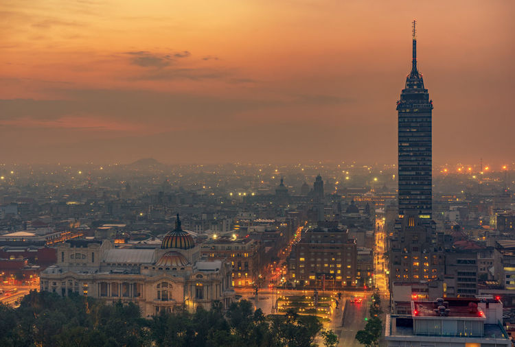 Torre latinoamericana amidst buildings in city at sunset