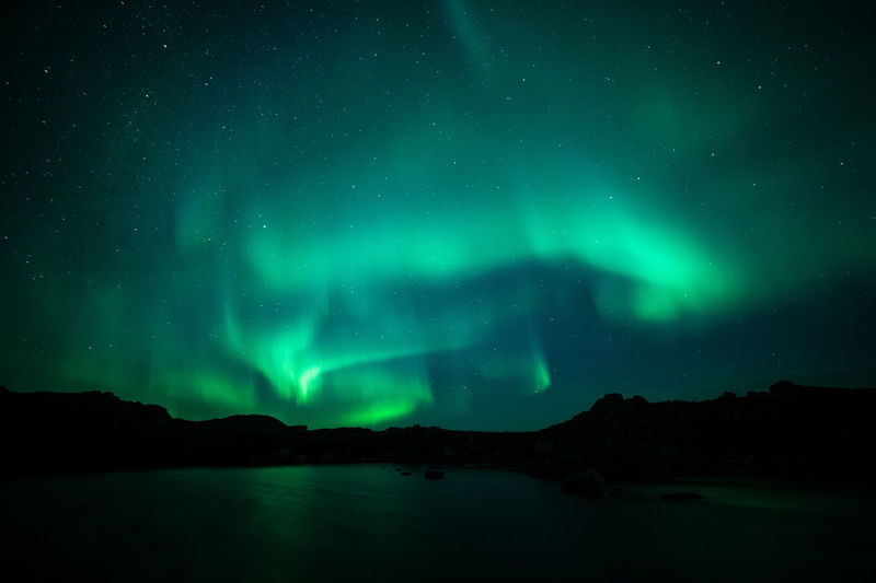 Aurora Polaris Nature Night Travel Destinations Outdoors Sky Astronomy No People Landscape Space Polar Climate Illuminated Green Color Beauty In Nature Scenics Atmospheric Mood Tranquility Wonderlust Mountain Star - Space First Eyeem Photo Perspectives On Nature