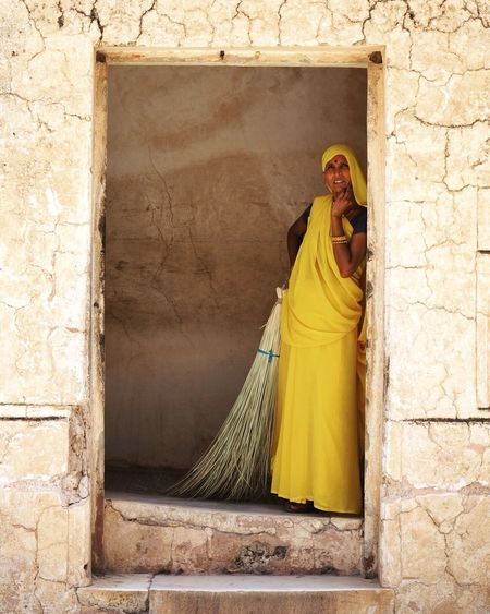 The Portraitist - 2017 EyeEm Awards Cultures Religion Traditional Clothing Architecture Yellow Day Built Structure Low Angle View Standing Outdoors Sari Building Exterior One Person People