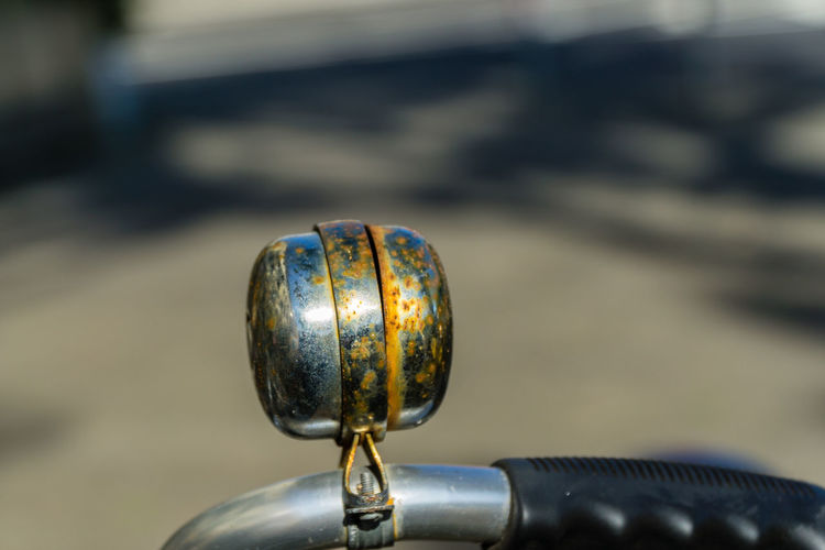 Close-up of rusty bicycle bell