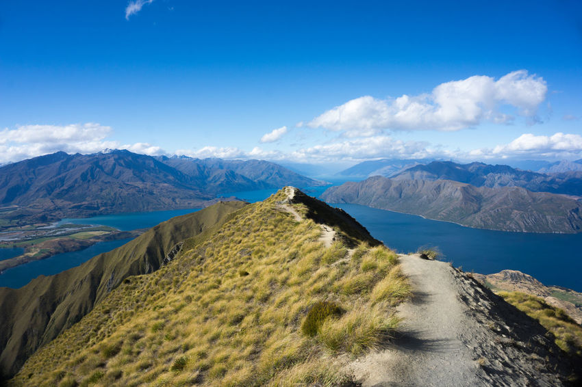 Roys Peak New Zealand Scenery Wanaka Beauty In Nature Blue Cloud - Sky Day Lakescape Landscape Landscapes Mountain Mountain Range Nature New Zealand No People Outdoors Physical Geography Roys Peak Scenics Sky Tranquil Scene Tranquility Water