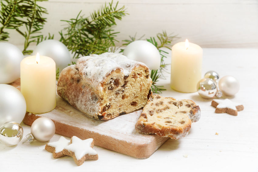 christstollen, typical german christmas cake with candles, baubles and cinnamon star cookies on a rustic white wooden table Baubles Candles.❤ Christmas Holiday Trees Baking Cake Christstollen Day Decoration Fir Food Food And Drink Freshness Indoors  No People Ready-to-eat Sweet Table Traditional White