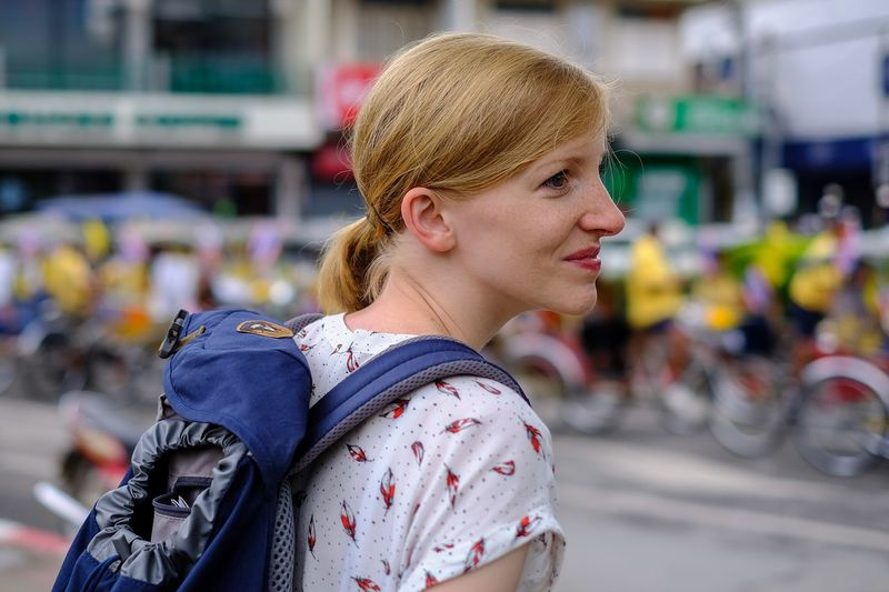 Side view of woman looking away outdoors