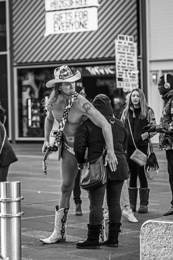 """""""Gifts for Everyone"""" Cowboy Times Square NYC Building Exterior Casual Clothing City Clothing Day Focus On Foreground Full Length Group Of People Hat Leisure Activity Lifestyles Men People Real People Standing Street Women The Street Photographer - 2018 EyeEm Awards The Art Of Street Photography My Best Photo"""