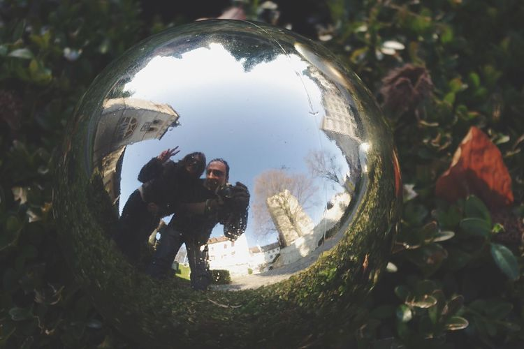 Real People Reflection Leisure Activity Lifestyles Day Outdoors Nature Tree People Two People Man Woman Fun Christmas Ball Christmas Ornament Street Buildings Spherical