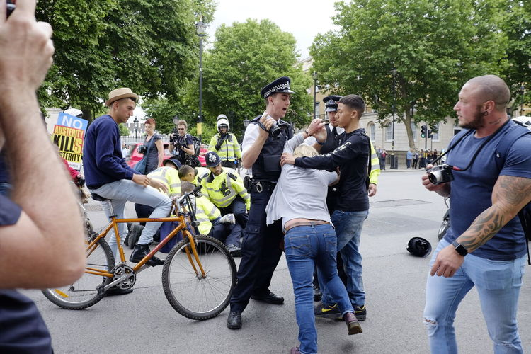 Protester resisting arrest by London Metropolitan Police in front of the gates of Downing Street on July 1, 2017 in London, UK. Protester Protest Resist Arrest Metropolitan Police London Downing Street Not One Day More Demostration Activist  Activism Rally People Crowd Go Higher Adventures In The City Focus On The Story