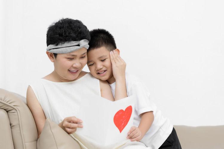 Happy couple holding heart shape
