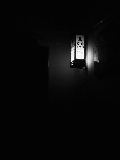 Eye check up. EyeEm Selects Eye Alphabet Doctor  Eye Check Eyesight Vision Medical Letters Blackandwhite Black And White Mobilephotography PhonePhotography Illuminated Clock Face Copy Space Electric Light Lighting Equipment