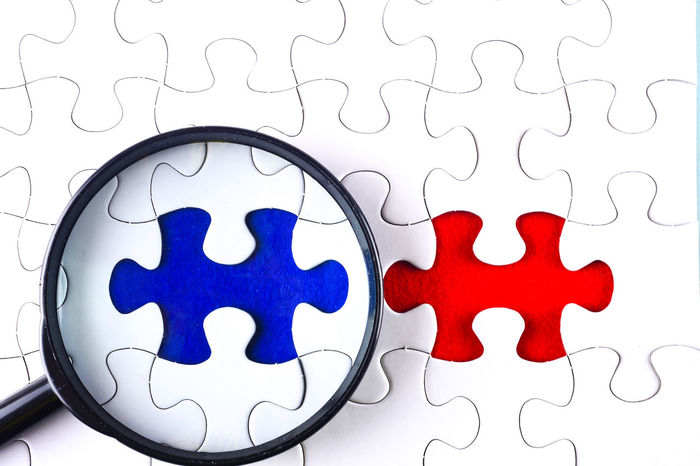 magnifying glass on jigsaw puzzle Choice Close-up Concept Conceptual Day Indoors  Jigsaw Puzzle Magnifying Glass No People Problem Solving Puzzle  Success True Or False White Background