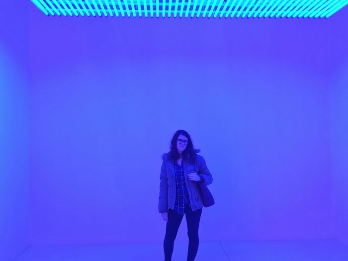 Blue space Space Empty Space Light Neon Blue One Person Front View Young Women Standing Lifestyles Blue Indoors
