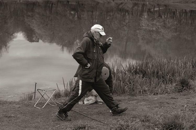 Full length of man walking by lake
