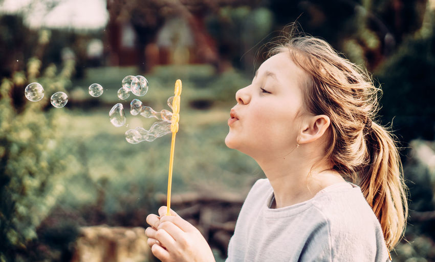 Girl looking at bubbles