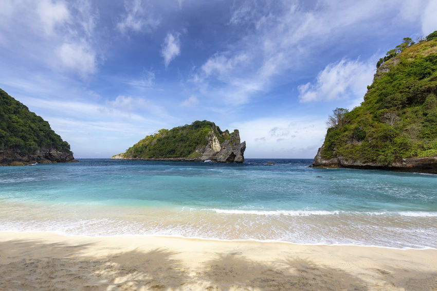Shade and calm surf at Atuh Beach, a popular tourist area of Nusa Penida. ASIA Atuh Beach Bali Diving INDONESIA Snorkeling Sunny Travel Aquamarine Atuh Balinese Beach Blue Destination Diamond Klungkung Nusa Penida Paradise Pejukutan Relax Summer Swim Tourism Tropical White Sand