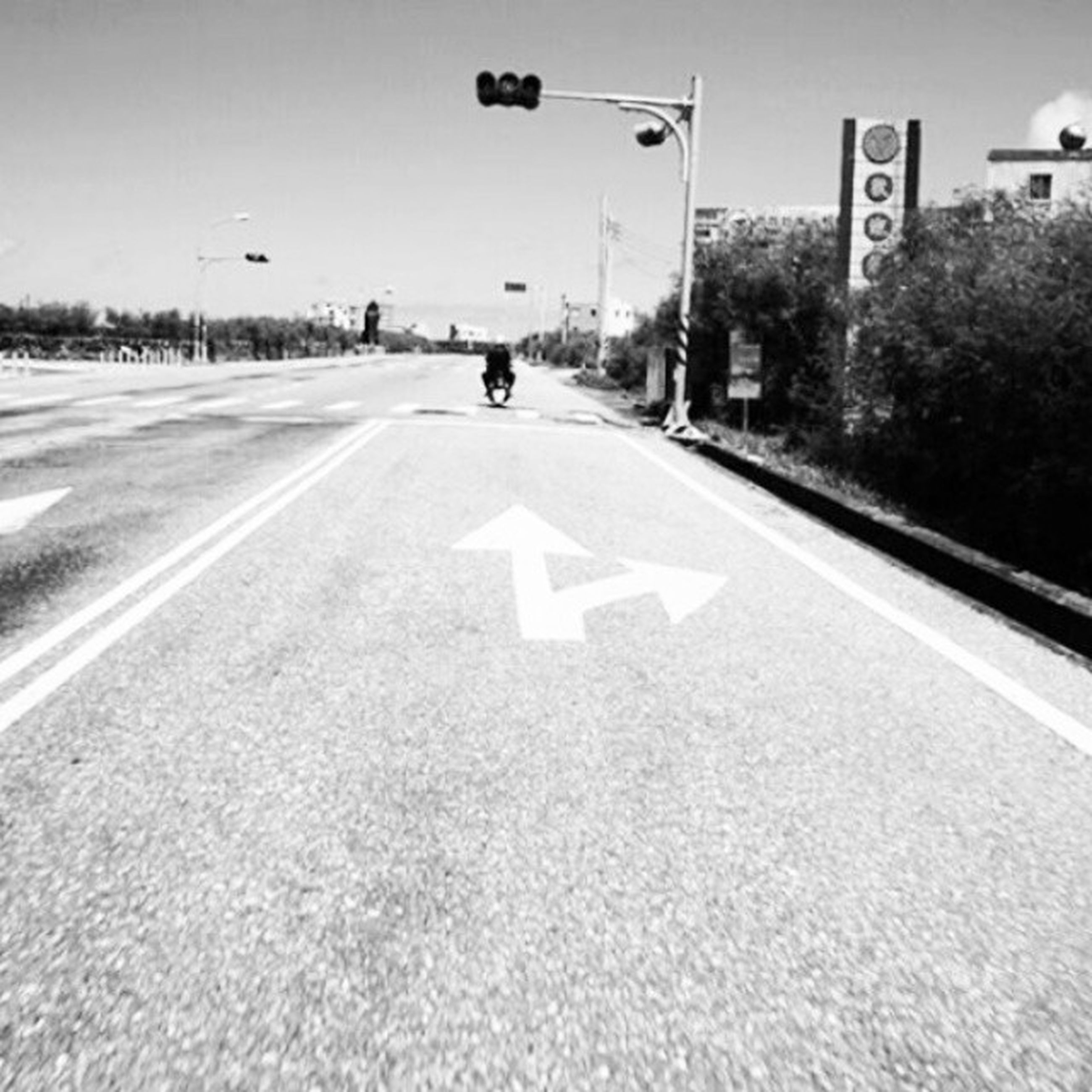 transportation, road marking, the way forward, road sign, road, guidance, communication, arrow symbol, sign, text, information sign, western script, directional sign, diminishing perspective, street, asphalt, vanishing point, direction, tree, arrow sign