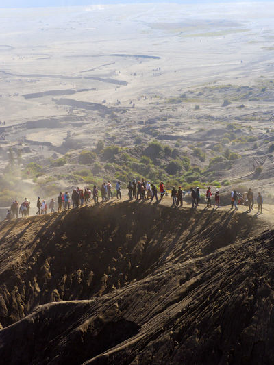 In the morning, Tourists walking on the hill of surrounding Mount Bromo. These hills were formed by the eruption of Mount Bromo in 2011. Any eruption of Mount Bromo could change the terrain. Environment Scenics - Nature Mount Bromo Nature Landscape Destination Vacations Holiday Wonderful Indonesia Scenic View Epic Shot Photography Tranquility Tranquil Scene Iconic Landmark Tourism Destination Foggy Sand Bromo Tengger Semeru National Park Sunrise Bromo Eruption Bromo Terrain Desert Landscape EyeEm Nature Lover EyeEm Best Shots