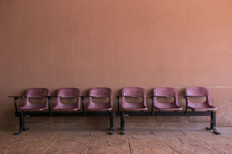 Absence Arrangement Brown Chair Copy Space Empty Group Of Objects In A Row Indoors  Large Group Of Objects No People Order Relaxation Retro Styled Seat Side By Side Table Tiled Floor Wall Wall - Building Feature Wood - Material