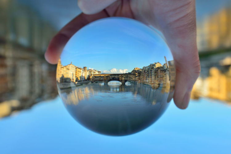 Crystal Ball Prospettive Architecture Building Exterior Built Structure City Clear Sky Close-up Day Florence Human Body Part Human Hand Men Nature One Person Outdoors People Photographer Real People Reflection Sky Turism Water Waterfront