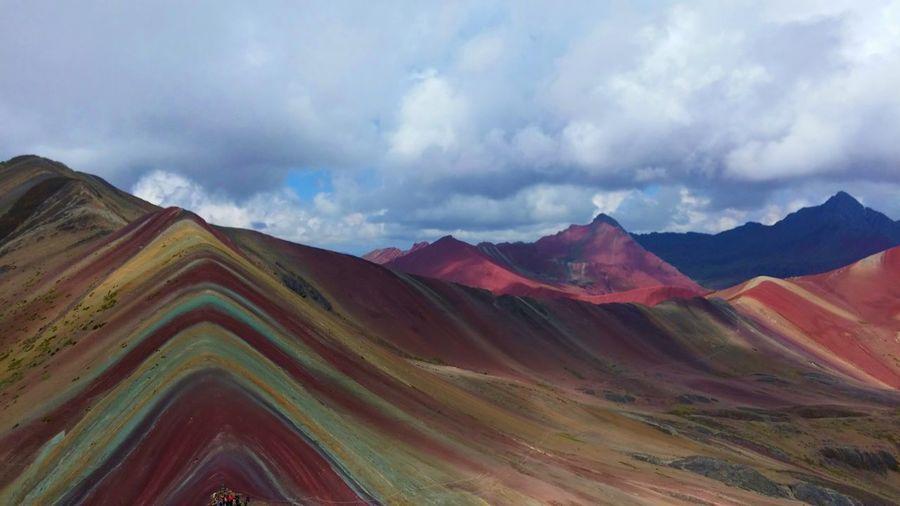 Idyllic shot of rainbow mountains against cloudy sky