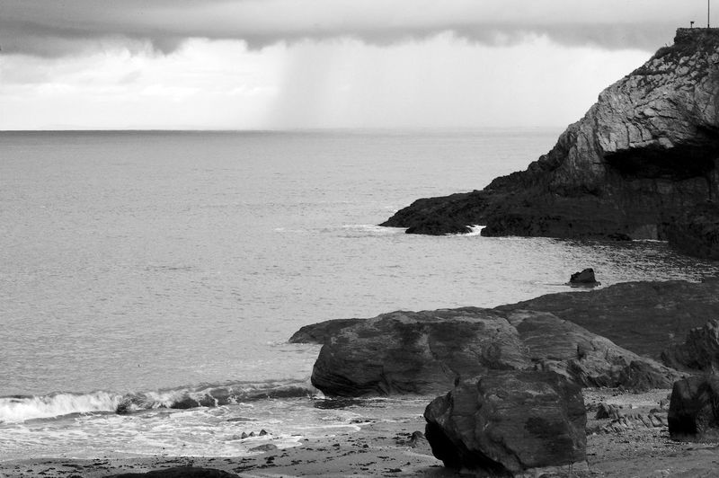 Incoming Rain Black & White Beach Beauty In Nature Blackandwhite Cliff Day Horizon Over Water Nature No People Outdoors Rock Rock - Object Rock Formation Scenery Scenics Sea Sky Tranquil Scene Tranquility Water